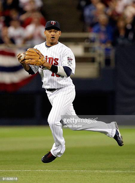 Shortstop Orlando Cabrera of the Minnesota Twins looks toward first after fielding a ground ball during the American League Tiebreaker game against...