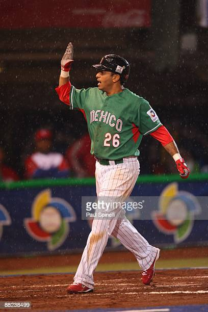 Shortstop Oscar Robles of Mexico gets a high five after hitting a third inning home run against Cuba in Pool B game 6 in the first round of the 2009...