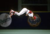 Shortstop Ozzie Smith of the St Louis Cardinals does a back flip going onto the field before a MLB Baseball game at Busch Stadium in St Louis...