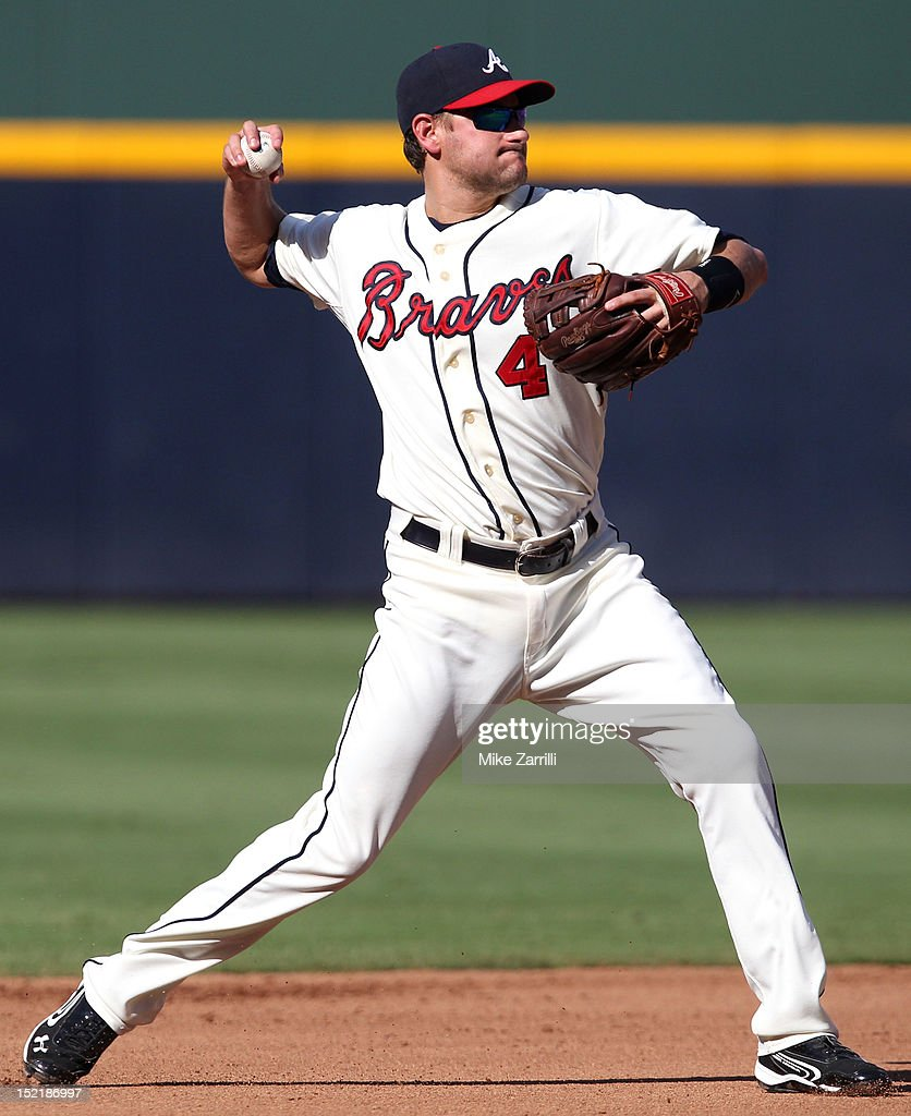Shortstop <a gi-track='captionPersonalityLinkClicked' href=/galleries/search?phrase=Paul+Janish&family=editorial&specificpeople=4174475 ng-click='$event.stopPropagation()'>Paul Janish</a> #4 of the Atlanta Braves makes a play on a ground ball during the game against the Philadelphia Phillies at Turner Field on September 1, 2012 in Atlanta, Georgia.