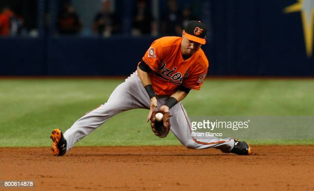 Shortstop Paul Janish of the Baltimore Orioles starts out the double play grounder by Daniel Robertson of the Tampa Bay Rays during the third inning...