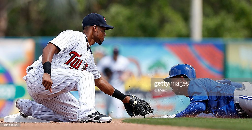 Shortstop Pedro Florimon #25 of the Minnesota Twins applies the tag to outfielder Anthnoy Gose #8 of the Toronto Blue Jays as he tried to steal second base during a Grapefruit League Spring Training Game at Hammond Stadium on March 24, 2013 in Fort Myers, Florida.