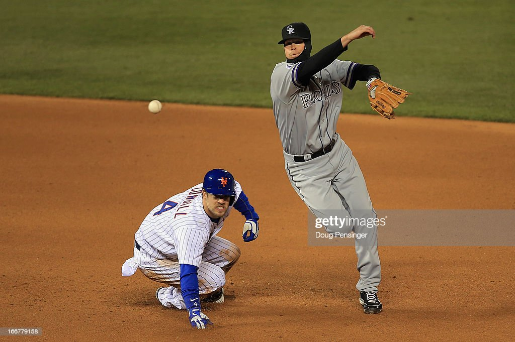 Shortstop Reid Brignac #16 of the Colorado Rockies gets a force out on Collin Cowgill #4 of the New York Mets but is unable to complete the double play on Daniel Murphy of the New York Mets in the fifth inning at Coors Field on April 16, 2013 in Denver, Colorado.