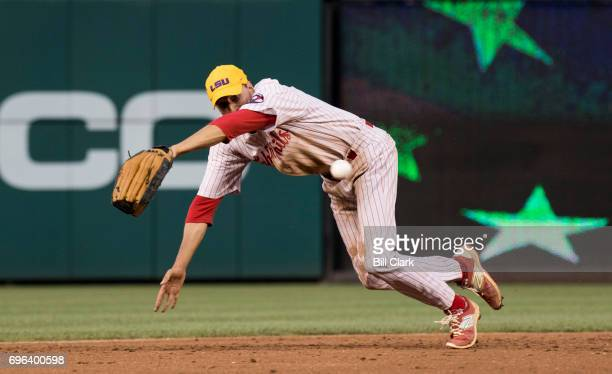 GOP shortstop Rep Ryan Costello RPa dives for a ground ball during the 2nd inning of the annual Congressional Baseball Game at Nationals Park in...