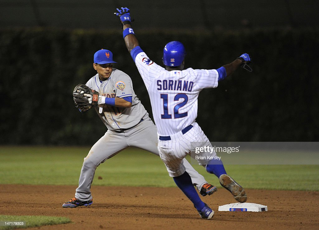 Shortstop <a gi-track='captionPersonalityLinkClicked' href=/galleries/search?phrase=Ruben+Tejada&family=editorial&specificpeople=5754705 ng-click='$event.stopPropagation()'>Ruben Tejada</a> #11 of the New York Mets (L) forces out <a gi-track='captionPersonalityLinkClicked' href=/galleries/search?phrase=Alfonso+Soriano&family=editorial&specificpeople=202251 ng-click='$event.stopPropagation()'>Alfonso Soriano</a> #12 of the Chicago Cubs at second base on a ground ball hit by Bryan LaHair #6 during the seventh inning at Wrigley Field on June 26, 2012 in Chicago, Illinois.