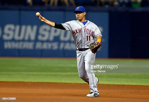 Shortstop Ruben Tejada of the New York Mets makes the throw to first base for the out on James Loney of the Tampa Bay Rays to end the fourth inning...