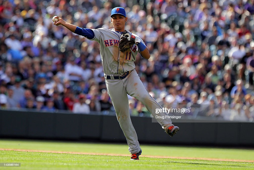 Shortstop <a gi-track='captionPersonalityLinkClicked' href=/galleries/search?phrase=Ruben+Tejada&family=editorial&specificpeople=5754705 ng-click='$event.stopPropagation()'>Ruben Tejada</a> #11 of the New York Mets throws out a runner against the Colorado Rockies at Coors Field on April 29, 2012 in Denver, Colorado. The Mets defeated the Rockies 6-5 in 11 innings.