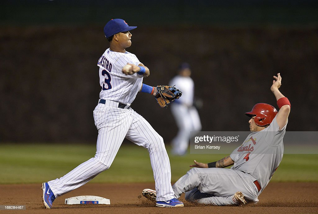 Shortstop <a gi-track='captionPersonalityLinkClicked' href=/galleries/search?phrase=Starlin+Castro&family=editorial&specificpeople=5970945 ng-click='$event.stopPropagation()'>Starlin Castro</a> #13 of the Chicago Cubs (L) forces out <a gi-track='captionPersonalityLinkClicked' href=/galleries/search?phrase=Yadier+Molina&family=editorial&specificpeople=172002 ng-click='$event.stopPropagation()'>Yadier Molina</a> #4 of the St. Louis Cardinals at second base on a ground ball hit by David Freese #23 during the fourth inning on May 7, 2013 at Wrigley Field in Chicago, Illinois. Freese was safe at first base.