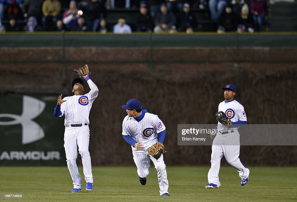 Shortstop <a gi-track='captionPersonalityLinkClicked' href=/galleries/search?phrase=Starlin+Castro&family=editorial&specificpeople=5970945 ng-click='$event.stopPropagation()'>Starlin Castro</a> of the Chicago Cubs (L) gets under a pop fly hit by Nelson Cruz of the Texas Rangers as second baseman <a gi-track='captionPersonalityLinkClicked' href=/galleries/search?phrase=Darwin+Barney&family=editorial&specificpeople=537975 ng-click='$event.stopPropagation()'>Darwin Barney</a> (C) and center fielder <a gi-track='captionPersonalityLinkClicked' href=/galleries/search?phrase=Dave+Sappelt&family=editorial&specificpeople=7510516 ng-click='$event.stopPropagation()'>Dave Sappelt</a> close in on the play during the first inning at Wrigley Field on April 16, 2013 in Chicago, Illinois.