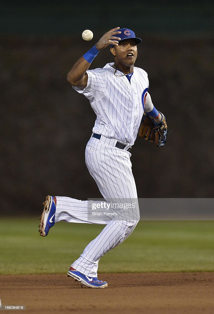 Shortstop <a gi-track='captionPersonalityLinkClicked' href=/galleries/search?phrase=Starlin+Castro&family=editorial&specificpeople=5970945 ng-click='$event.stopPropagation()'>Starlin Castro</a> #13 of the Chicago Cubs makes a fielding error on a ground ball hit by Jon Jay #19 of the St. Louis Cardinals during the fourth inning on May 7, 2013 at Wrigley Field in Chicago, Illinois.