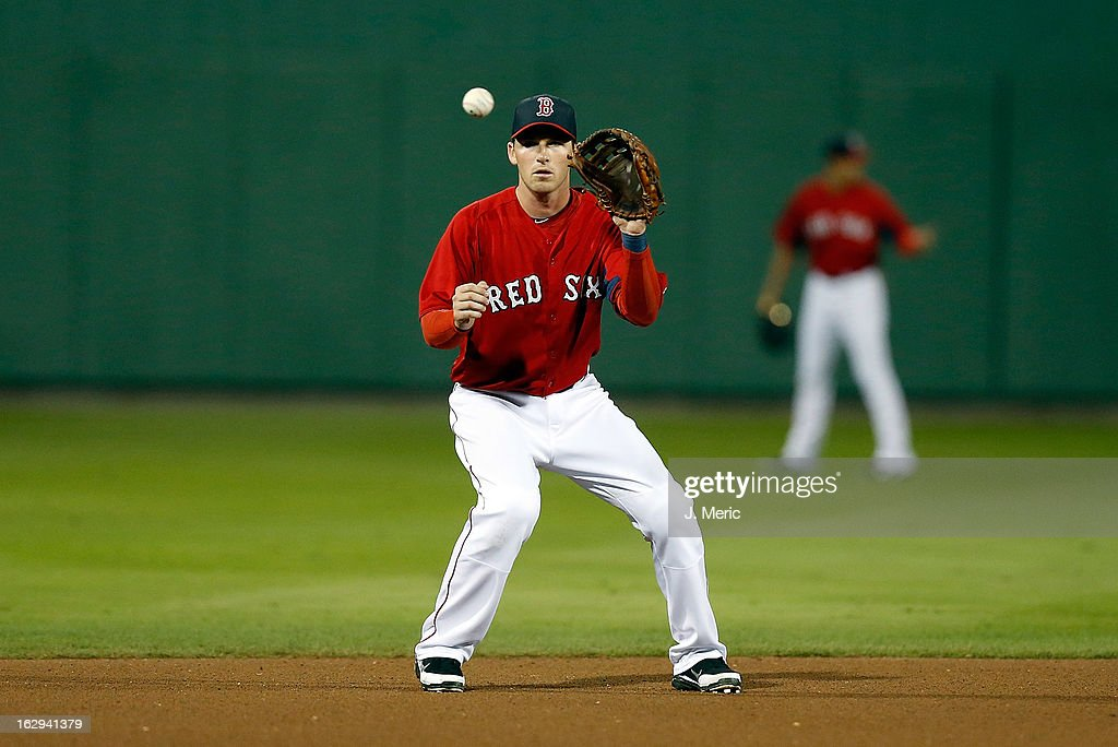 Shortstop Stephen Drew #7 of the Boston Red Sox catches a ball against the Pittsburgh Pirates during a Grapefruit League Spring Training Game at JetBlue Park on March 1, 2013 in Fort Myers, Florida.