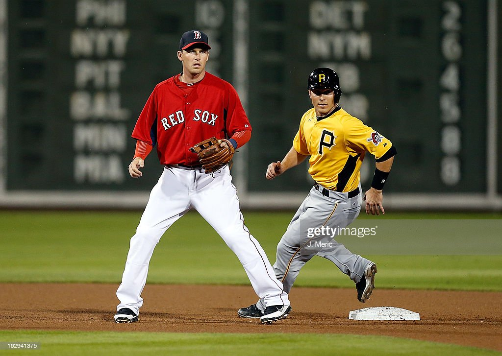 Shortstop <a gi-track='captionPersonalityLinkClicked' href=/galleries/search?phrase=Stephen+Drew&family=editorial&specificpeople=757520 ng-click='$event.stopPropagation()'>Stephen Drew</a> #7 of the Boston Red Sox looks for the throw as catcher Lucas May #73 of the Pittsburgh Pirates advances to second during a Grapefruit League Spring Training Game at JetBlue Park on March 1, 2013 in Fort Myers, Florida.
