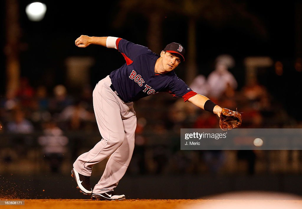 Shortstop <a gi-track='captionPersonalityLinkClicked' href=/galleries/search?phrase=Stephen+Drew&family=editorial&specificpeople=757520 ng-click='$event.stopPropagation()'>Stephen Drew</a> #7 of the Boston Red Sox reaches for a ground ball against the Baltimore Orioles during a Grapefruit League Spring Training Game at Ed Smith Stadium on February 27, 2013 in Sarasota, Florida.