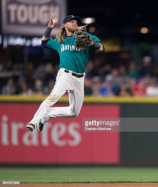 Shortstop Taylor Motter of the Seattle Mariners makes a throw to first base on a ball hit by Ezequiel Carrera of the Toronto Blue Jays during the...