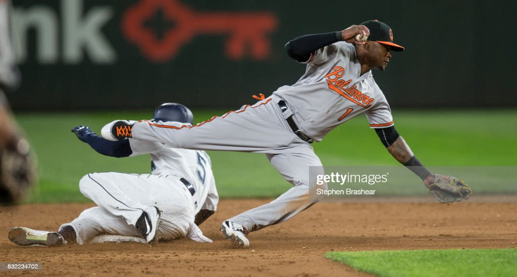 Shortstop Tim Beckham #1 of the Baltimore Orioles is unable to complete a double play after forcing out Guillermo Heredia #5 of the Seattle Mariners at second base on a ball hit by hit by Robinson Cano #22 of the Seattle Mariners off of starting pitcher Wade Miley #38 of the Baltimore Orioles that allowed Jarrod Dyson #1 of the Seattle Mariners to score during the fifth inning of a game at Safeco Field on August 15, 2017 in Seattle, Washington.