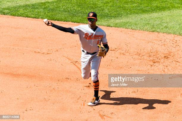 Shortstop Tim Beckham of the Baltimore Orioles throws out Edwin Encarnacion of the Cleveland Indians at first to end the fifth inning at Progressive...
