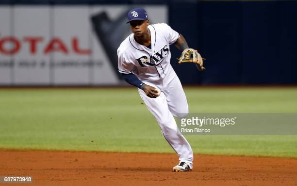 Shortstop Tim Beckham of the Tampa Bay Rays fields the ground out by Cliff Pennington of the Los Angeles Angels of Anaheim during the third inning of...