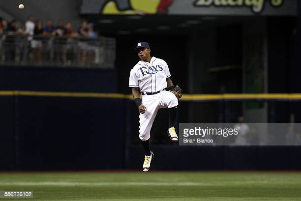 Shortstop Tim Beckham of the Tampa Bay Rays makes an attempt on the single by Jorge Polanco of the Minnesota Twins during the third inning of a game...