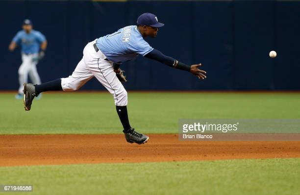 Shortstop Tim Beckham of the Tampa Bay Rays makes the toss to second baseman Brad Miller after Yuli Gurriel of the Houston Astros grounded into the...