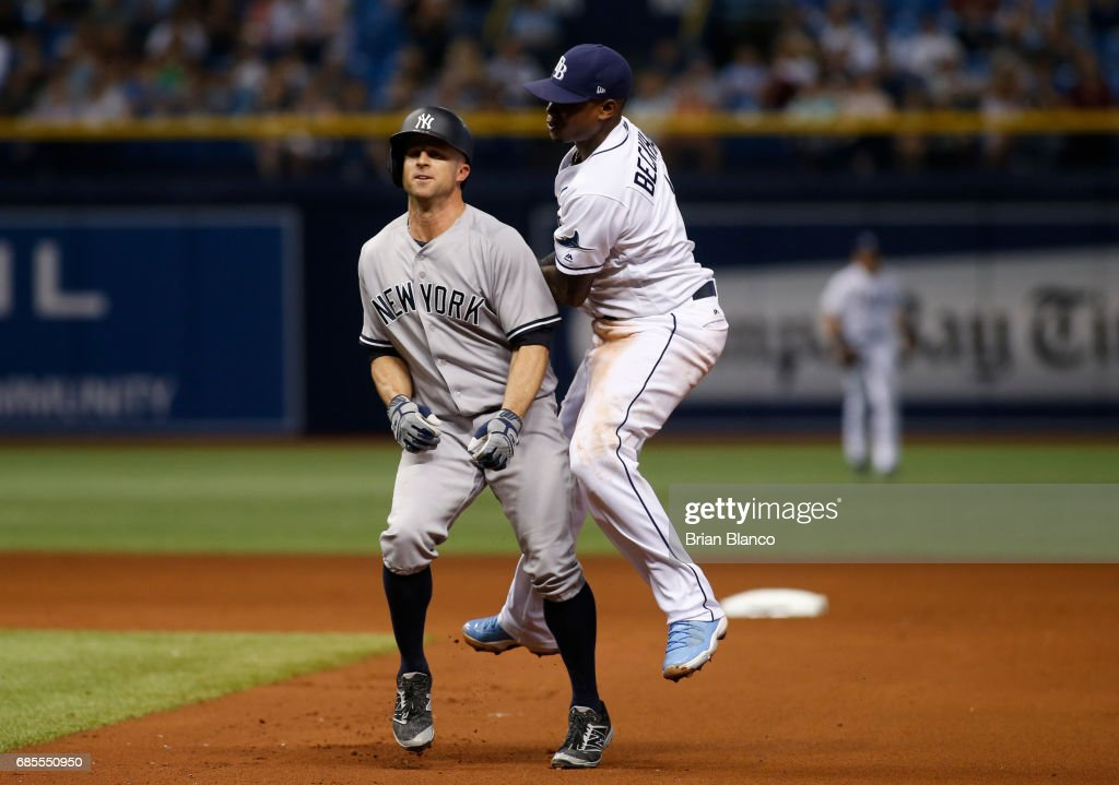 Shortstop Tim Beckham #1 of the Tampa Bay Rays tags out Brett Gardner #11 of the New York Yankees after Jacoby Ellsbury grounded into the double play to end the top of the fifth inning of a game on May 19, 2017 at Tropicana Field in St. Petersburg, Florida.