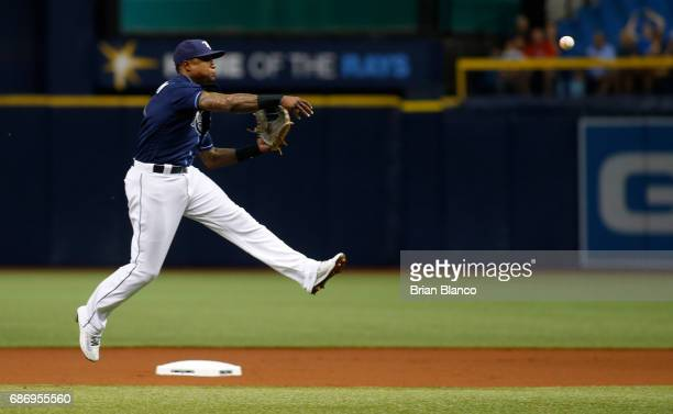Shortstop Tim Beckham of the Tampa Bay Rays throws to first base on a ball that was ruled a single off the bat of Cameron Maybin of the Los Angeles...