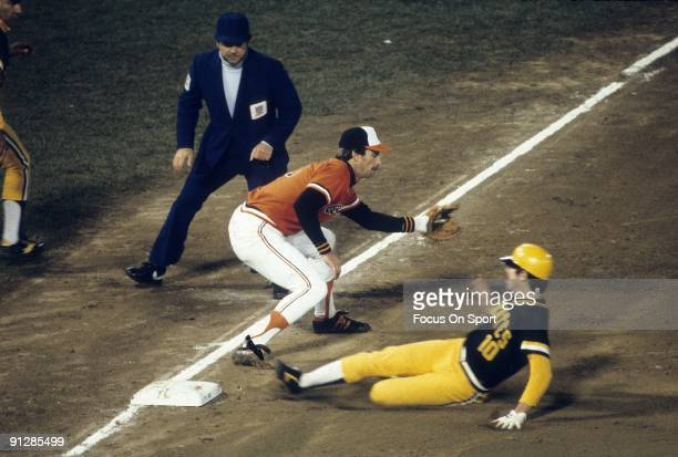 Shortstop Tim Foli slides into third base with Baltimore Orioles third baseman Doug DeCinces covering during a 1979 world series game between the...