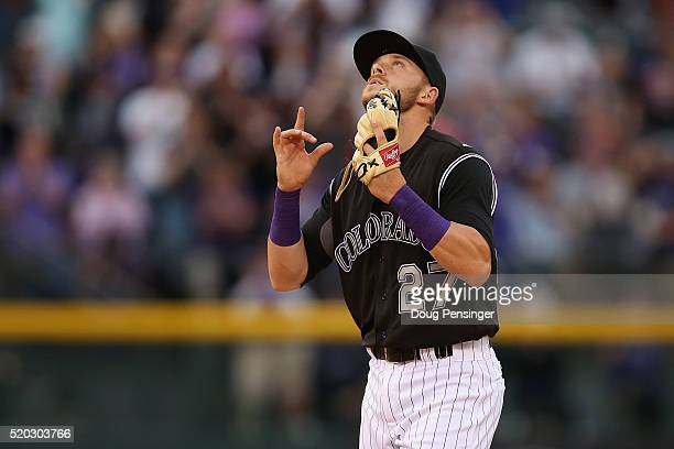 Shortstop Trevor Story of the Colorado Rockies celebrate the Rockies 63 victory over the San Diego Padres on April 10 2016 in Denver Colorado