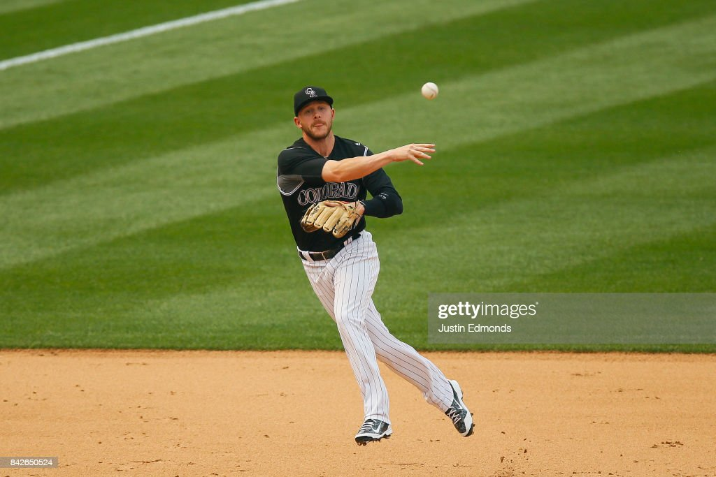 Shortstop Trevor Story #27 of the Colorado Rockies makes a throw on the run for the third out of the sixth inning against the San Francisco Giants at Coors Field on September 4, 2017 in Denver, Colorado. The Rockies defeated the Giants 4-3.