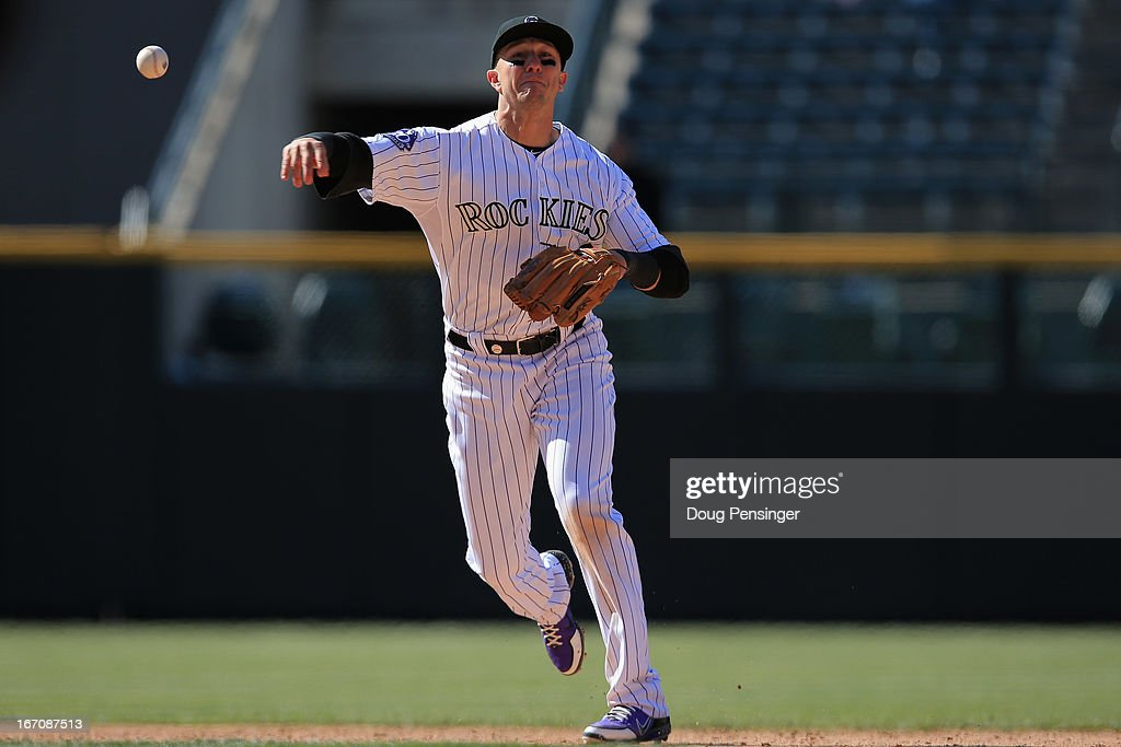 Shortstop <a gi-track='captionPersonalityLinkClicked' href=/galleries/search?phrase=Troy+Tulowitzki&family=editorial&specificpeople=757353 ng-click='$event.stopPropagation()'>Troy Tulowitzki</a> #2 of the Colorado Rockies fields a ground ball and throws out Ruben Tejada of the New York Mets for the final out of the game at Coors Field on April 18, 2013 in Denver, Colorado. The Rockies defeated the Mets 11-3.