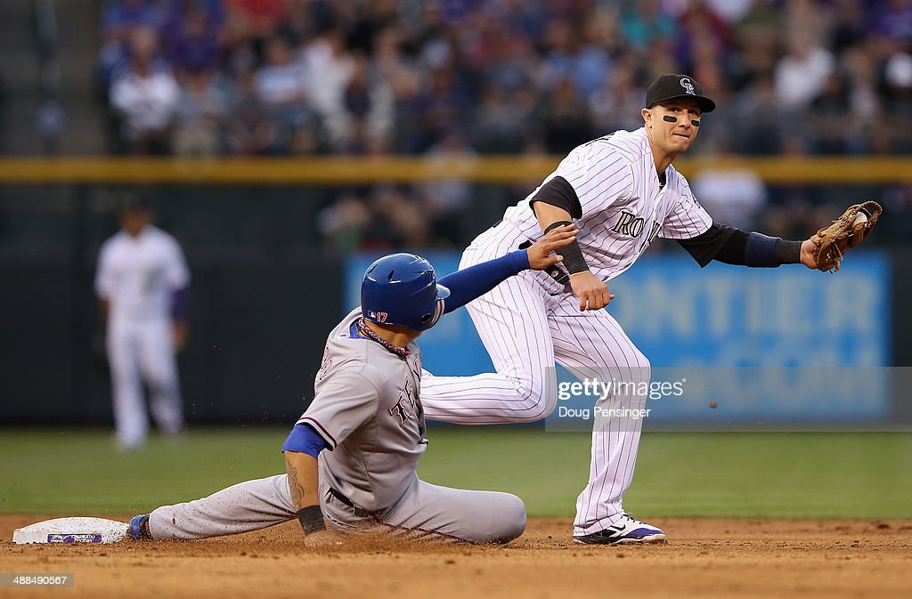 Shortstop <a gi-track='captionPersonalityLinkClicked' href=/galleries/search?phrase=Troy+Tulowitzki&family=editorial&specificpeople=757353 ng-click='$event.stopPropagation()'>Troy Tulowitzki</a> #2 of the Colorado Rockies gets a force out on <a gi-track='captionPersonalityLinkClicked' href=/galleries/search?phrase=Shin-Soo+Choo&family=editorial&specificpeople=196543 ng-click='$event.stopPropagation()'>Shin-Soo Choo</a> #17 of the Texas Rangers at second base in the third inning during Interleague play at Coors Field on May 6, 2014 in Denver, Colorado.