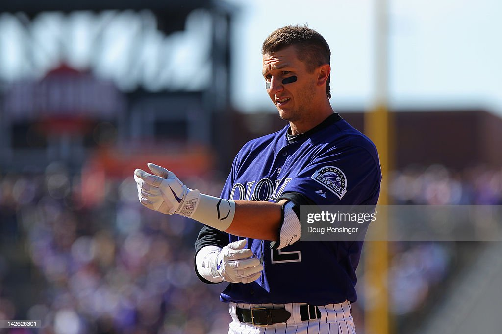 Shortstop <a gi-track='captionPersonalityLinkClicked' href=/galleries/search?phrase=Troy+Tulowitzki&family=editorial&specificpeople=757353 ng-click='$event.stopPropagation()'>Troy Tulowitzki</a> #2 of the Colorado Rockies looks on after being forced out against the San Francisco Giants on Opening Day at Coors Field on April 9, 2012 in Denver, Colorado. The Giants defeated the Rockies 7-0.
