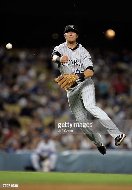 Shortstop Troy Tulowitzki of the Colorado Rockies makes a leaping throw to first base to record the out on a ball hit by ChinLung Hu of the Los...