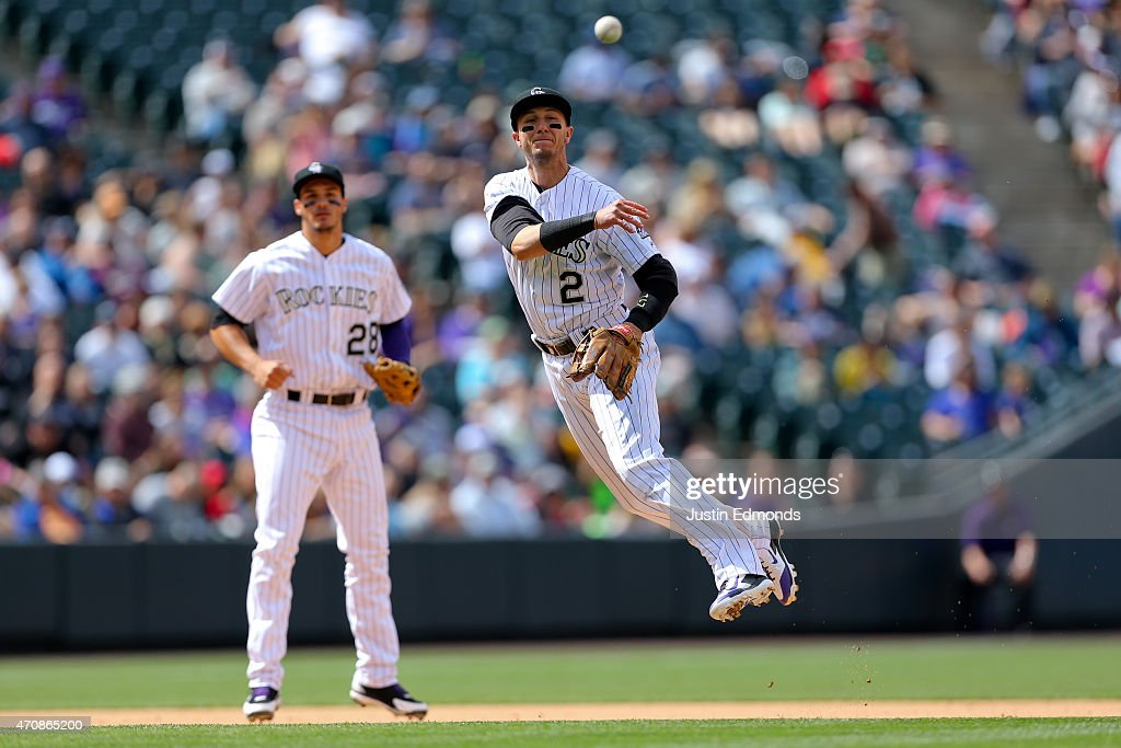 Shortstop Troy Tulowitzki #2 of the Colorado Rockies makes a throw on the run for the first out of the sixth inning as Nolan Arenado #28 looks on against the San Diego Padres at Coors Field on April 23, 2015 in Denver, Colorado. The Rockies defeated the Padres 2-1.
