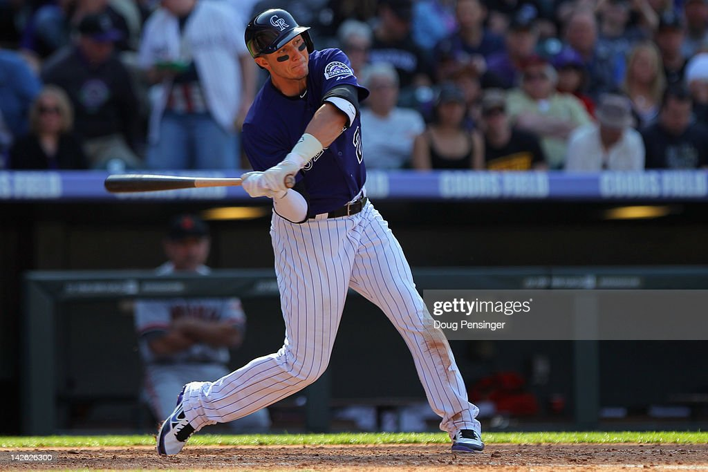 Shortstop <a gi-track='captionPersonalityLinkClicked' href=/galleries/search?phrase=Troy+Tulowitzki&family=editorial&specificpeople=757353 ng-click='$event.stopPropagation()'>Troy Tulowitzki</a> #2 of the Colorado Rockies takes an at bat against the San Francisco Giants on Opening Day at Coors Field on April 9, 2012 in Denver, Colorado. The Giants defeated the Rockies 7-0.
