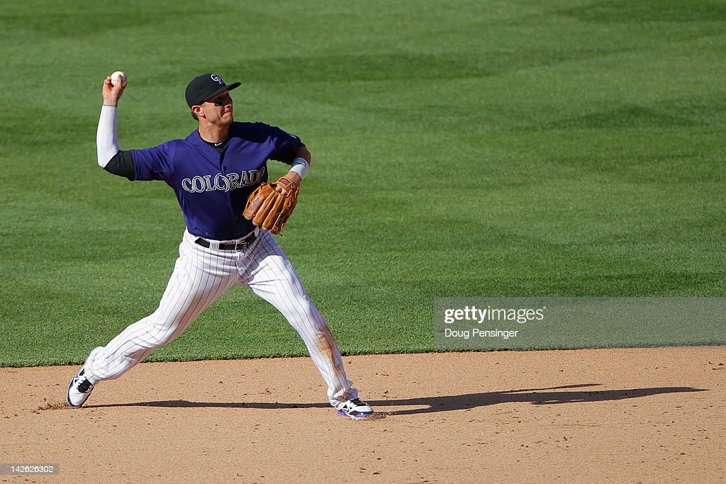 Shortstop <a gi-track='captionPersonalityLinkClicked' href=/galleries/search?phrase=Troy+Tulowitzki&family=editorial&specificpeople=757353 ng-click='$event.stopPropagation()'>Troy Tulowitzki</a> #2 of the Colorado Rockies throws out a runner against the San Francisco Giants on Opening Day at Coors Field on April 9, 2012 in Denver, Colorado. The Giants defeated the Rockies 7-0.