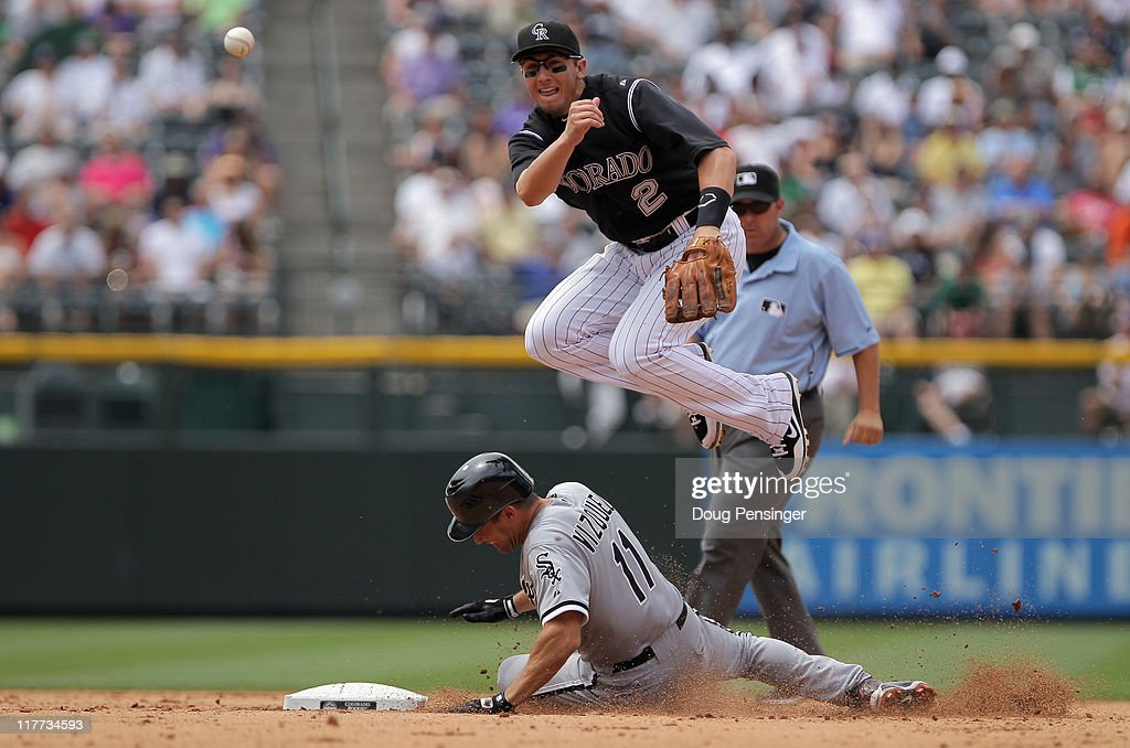 Shortstop <a gi-track='captionPersonalityLinkClicked' href=/galleries/search?phrase=Troy+Tulowitzki&family=editorial&specificpeople=757353 ng-click='$event.stopPropagation()'>Troy Tulowitzki</a> #2 of the Colorado Rockies turns a double play as he gets the force on <a gi-track='captionPersonalityLinkClicked' href=/galleries/search?phrase=Omar+Vizquel&family=editorial&specificpeople=201489 ng-click='$event.stopPropagation()'>Omar Vizquel</a> #11 of the Chicago White Sox at second on a ground ball by Adam Dunn of the White Sox in the fifth inning during Interleague play at Coors Field on June 30, 2011 in Denver, Colorado.