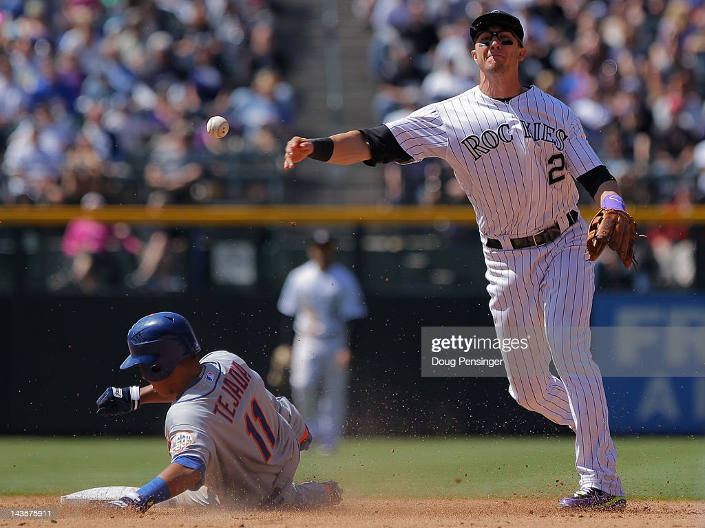 Shortstop Troy Tulowitzki #2 of the Colorado Rockies turns a double play on Ruben Tejada #11 of the New York Mets on a grounder by Daniel Murphy #28 of the New York Mets in the sixth inning at Coors Field on April 29, 2012 in Denver, Colorado.