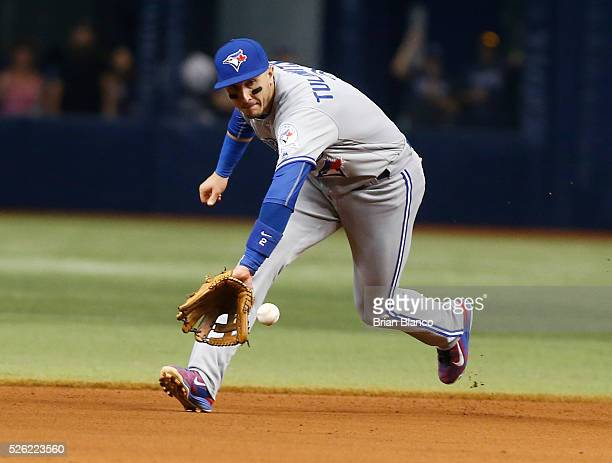 Shortstop Troy Tulowitzki of the Toronto Blue Jays fields the ground out by Logan Forsythe of the Tampa Bay Rays to end the seventh inning of a game...