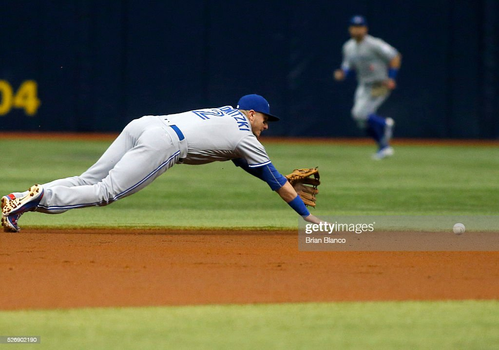 Shortstop <a gi-track='captionPersonalityLinkClicked' href=/galleries/search?phrase=Troy+Tulowitzki&family=editorial&specificpeople=757353 ng-click='$event.stopPropagation()'>Troy Tulowitzki</a> #2 of the Toronto Blue Jays makes an attempt on the single to center field by Logan Forsythe of the Tampa Bay Rays during the first inning of a game on May 1, 2016 at Tropicana Field in St. Petersburg, Florida.