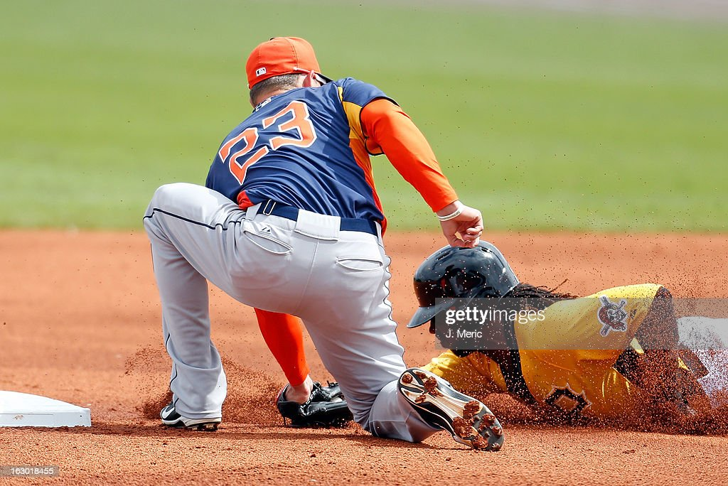 Shortstop Tyler Greene #23 of the Houston Astros applies the tag to outfielder Andrew McCutchen #22 of the Pittsburgh Pirates on a first inning steal attempt during a Grapefruit League Spring Training Game at McKechnie Field on March 3, 2013 in Bradenton, Florida.