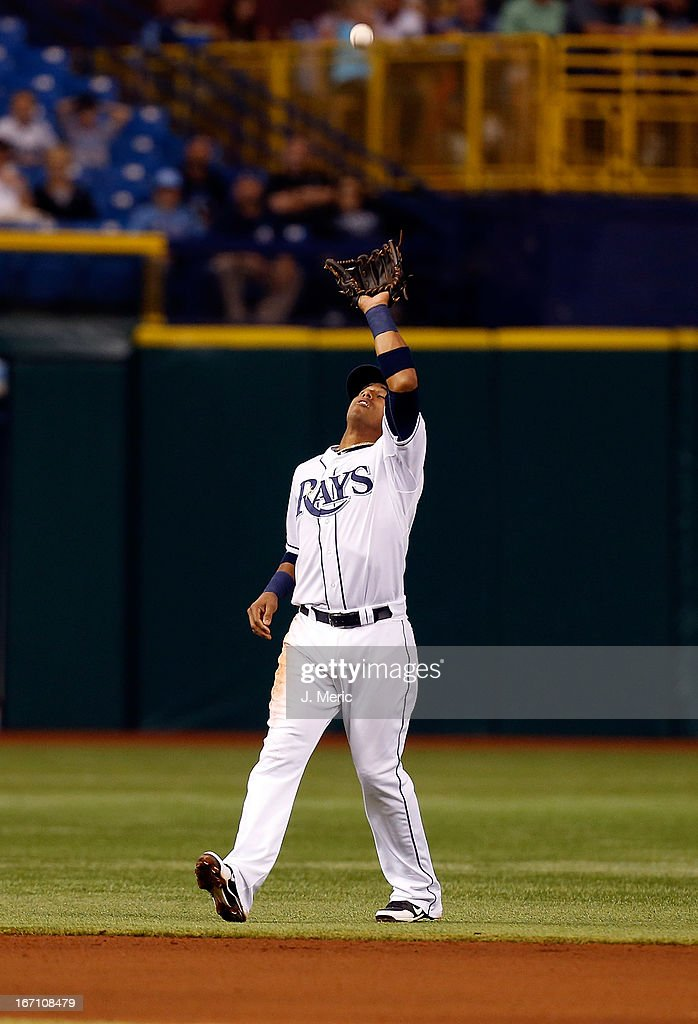 Shortstop <a gi-track='captionPersonalityLinkClicked' href=/galleries/search?phrase=Yunel+Escobar&family=editorial&specificpeople=757358 ng-click='$event.stopPropagation()'>Yunel Escobar</a> #11 of the Tampa Bay Rays catches a fly ball against the Oakland Athletics during the game at Tropicana Field on April 20, 2013 in St. Petersburg, Florida.