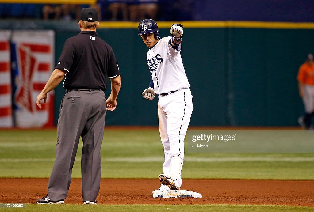 Shortstop <a gi-track='captionPersonalityLinkClicked' href=/galleries/search?phrase=Yunel+Escobar&family=editorial&specificpeople=757358 ng-click='$event.stopPropagation()'>Yunel Escobar</a> #11 of the Tampa Bay Rays celebrates his fifth-inning double against the Houston Astros during the game at Tropicana Field on July 13, 2013 in St. Petersburg, Florida.