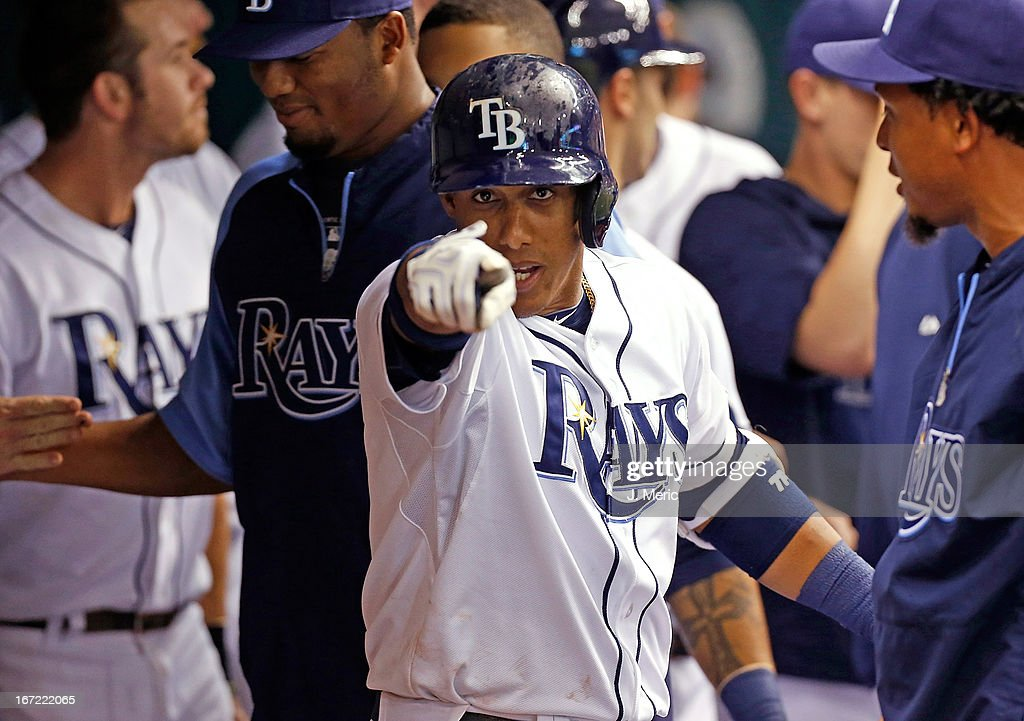 Shortstop <a gi-track='captionPersonalityLinkClicked' href=/galleries/search?phrase=Yunel+Escobar&family=editorial&specificpeople=757358 ng-click='$event.stopPropagation()'>Yunel Escobar</a> #11 of the Tampa Bay Rays celebrates his first inning home run against the New York Yankees at Tropicana Field on April 22, 2013 in St. Petersburg, Florida.