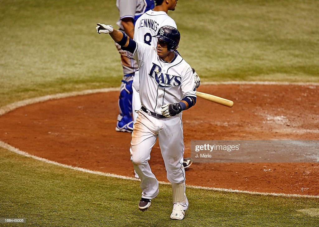 Shortstop <a gi-track='captionPersonalityLinkClicked' href=/galleries/search?phrase=Yunel+Escobar&family=editorial&specificpeople=757358 ng-click='$event.stopPropagation()'>Yunel Escobar</a> #11 of the Tampa Bay Rays celebrates his home run against the Toronto Blue Jays during the game at Tropicana Field on May 9, 2013 in St. Petersburg, Florida.