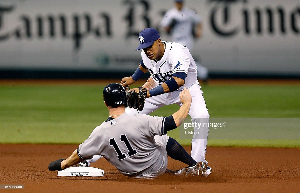 Shortstop <a gi-track='captionPersonalityLinkClicked' href=/galleries/search?phrase=Yunel+Escobar&family=editorial&specificpeople=757358 ng-click='$event.stopPropagation()'>Yunel Escobar</a> #11 of the Tampa Bay Rays forces outfielder <a gi-track='captionPersonalityLinkClicked' href=/galleries/search?phrase=Brett+Gardner&family=editorial&specificpeople=4172518 ng-click='$event.stopPropagation()'>Brett Gardner</a> #11 of the New York Yankees at second base at Tropicana Field on April 22, 2013 in St. Petersburg, Florida.