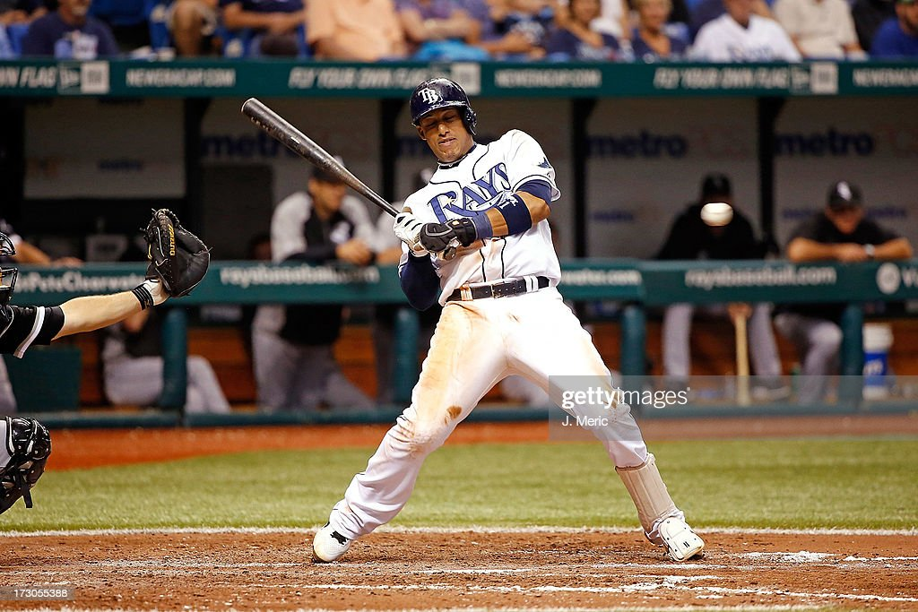 Shortstop <a gi-track='captionPersonalityLinkClicked' href=/galleries/search?phrase=Yunel+Escobar&family=editorial&specificpeople=757358 ng-click='$event.stopPropagation()'>Yunel Escobar</a> #11 of the Tampa Bay Rays gets out of the way of this inside pitch from the Chicago White Sox during the game at Tropicana Field on July 5, 2013 in St. Petersburg, Florida.