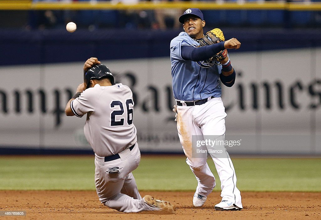 Shortstop Yunel Escobar #11 of the Tampa Bay Rays gets the out on Yangervis Solarte #26 of the New York Yankees after Brett Gardner of the New York Yankees grounded into a fielder's choice during the 12th inning of a game on April 20, 2014 at Tropicana Field in St. Petersburg, Florida.