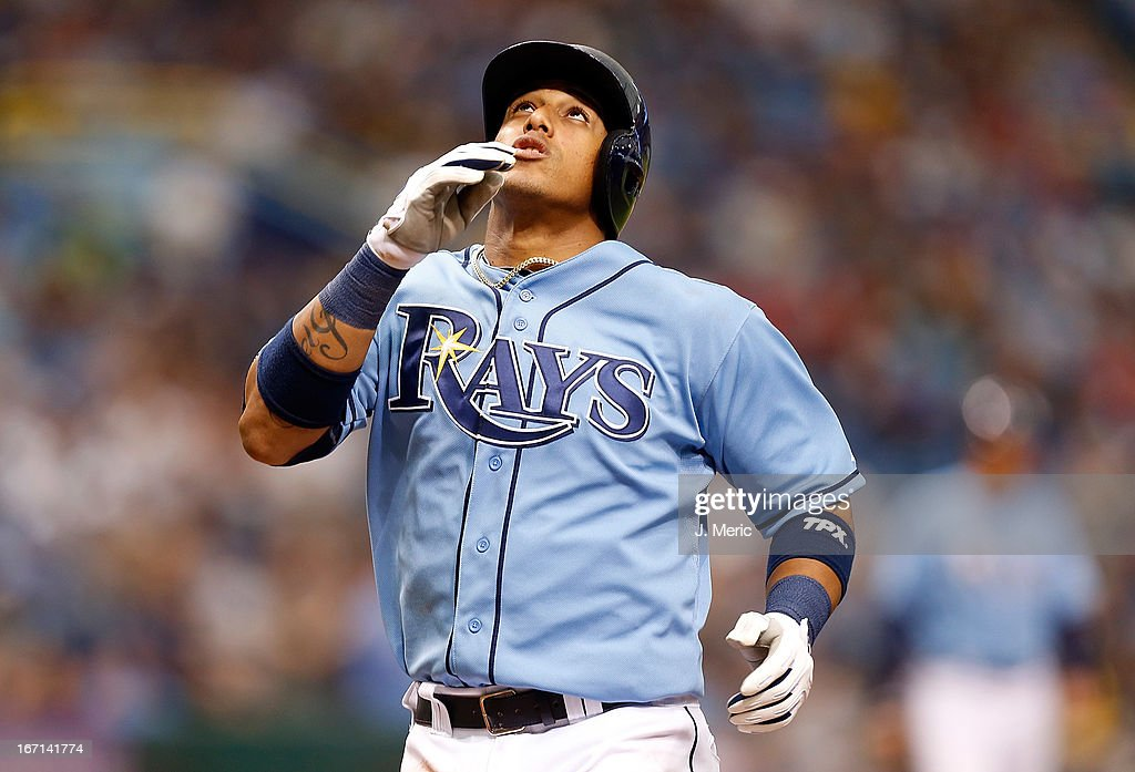 Shortstop Yunel Escobar #11 of the Tampa Bay Rays gives thanks after his second inning home run against the Oakland Athletics during the game at Tropicana Field on April 21, 2013 in St. Petersburg, Florida.