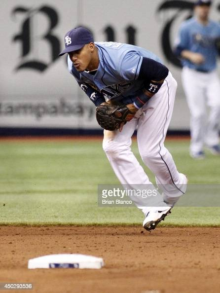 Shortstop Yunel Escobar of the Tampa Bay Rays hauls in the ground ball by James Jones of the Seattle Mariners during the eighth inning of a game on...