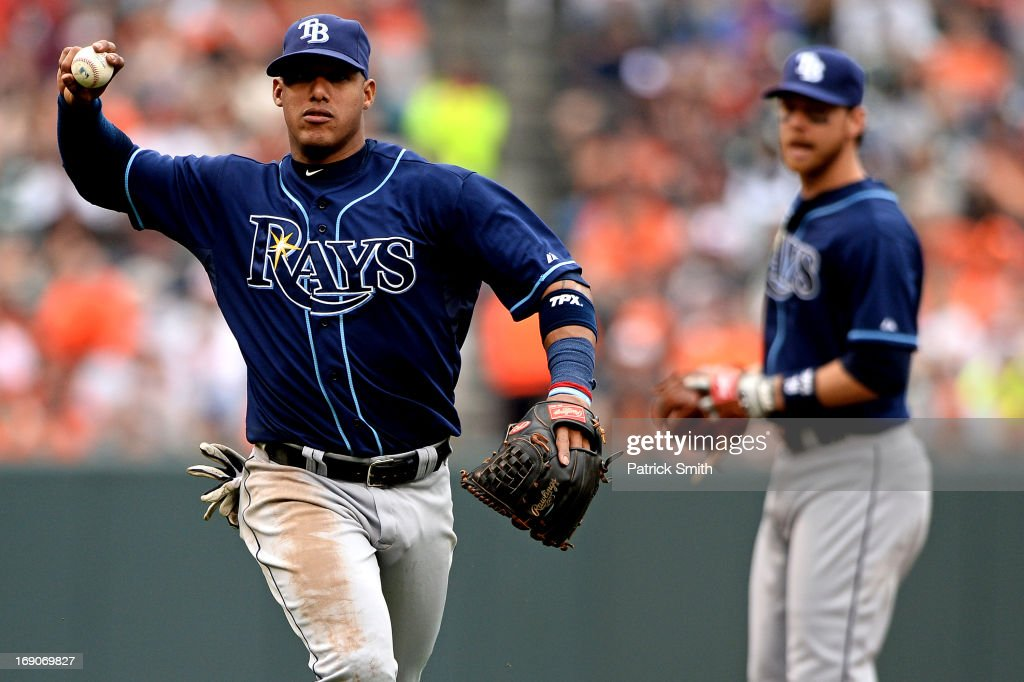 Shortstop <a gi-track='captionPersonalityLinkClicked' href=/galleries/search?phrase=Yunel+Escobar&family=editorial&specificpeople=757358 ng-click='$event.stopPropagation()'>Yunel Escobar</a> #11 of the Tampa Bay Rays makes an out against the Baltimore Orioles in the third inning at Oriole Park at Camden Yards on May 19, 2013 in Baltimore, Maryland. The Tampa Bay Rays won, 3-1.